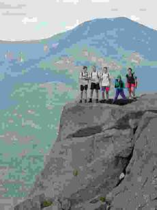 low-res photo of hiking group on rock
